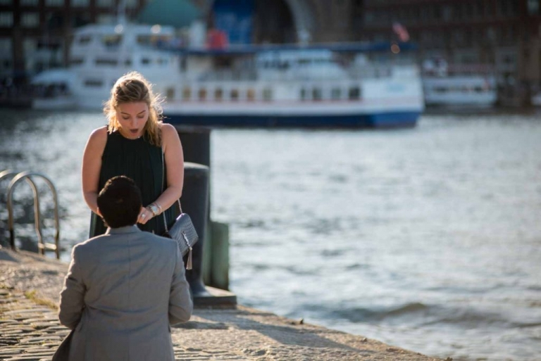 suprise wedding proposal at fan pier ocean in the background