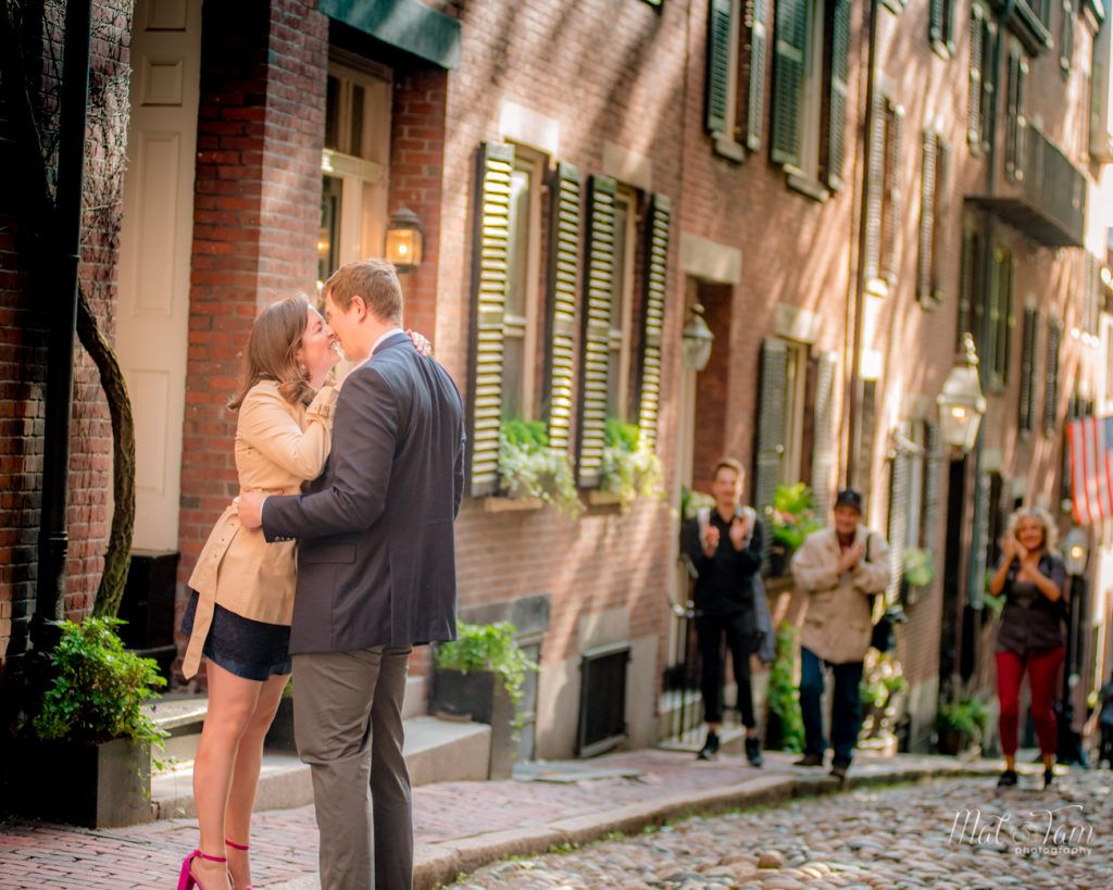 newly engaged couple kissing at acorn street. people in the background were clapping