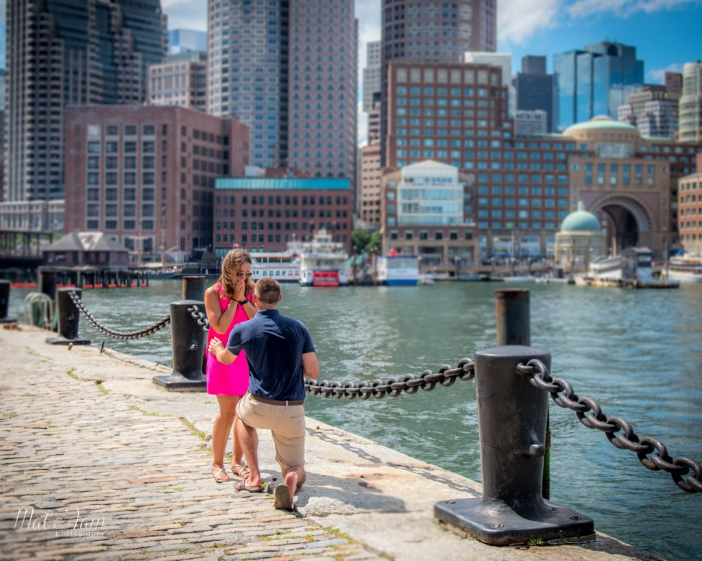 Proposal by the waterfront with a beautiful city background.