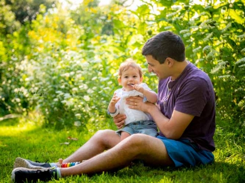 father-and-son-candid-sitting-on-grass